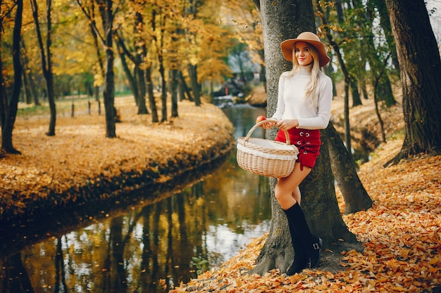 Beautiful woman in a autumn park Free Photo