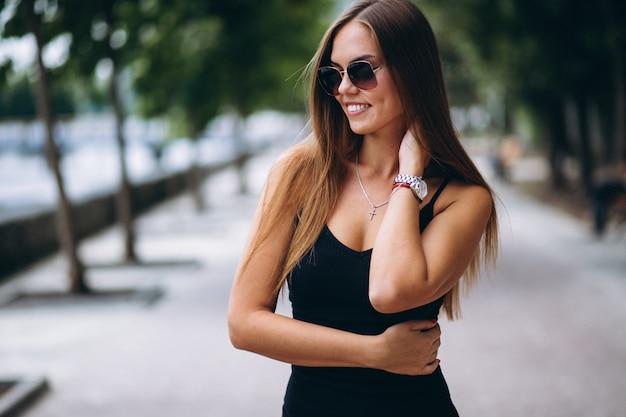 Beautiful woman in black dress Free Photo