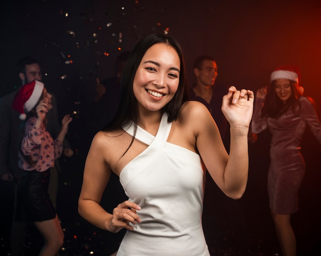 Beautiful woman dancing at new years party Free Photo