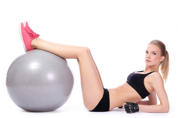 Beautiful woman doing abs exercises with fitness ball Free Photo