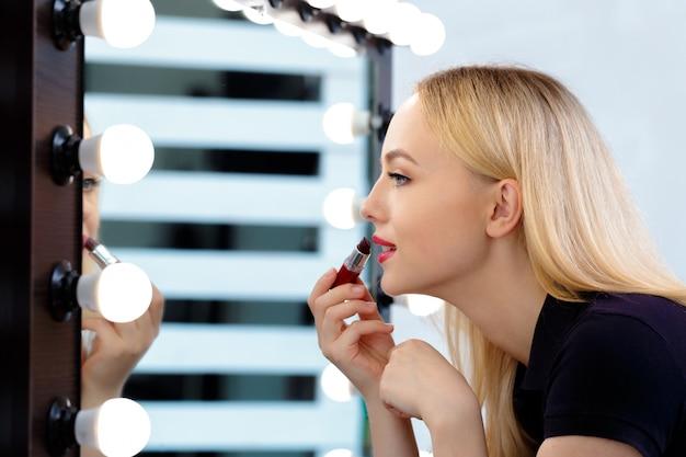 Beautiful woman doing evening makeup Premium Photo
