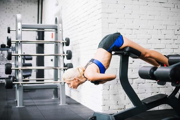 Beautifulwoman doing exercises for back Free Photo