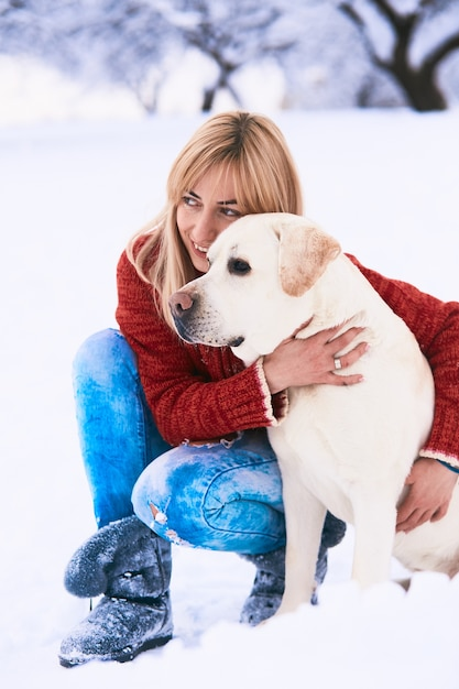 The beautiful woman embracing a dog Free Photo