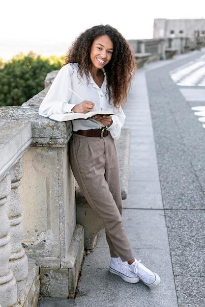Beautiful woman enjoying a day off reading Free Photo