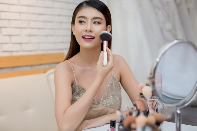 Beautiful woman face and hand of make-up Free Photo