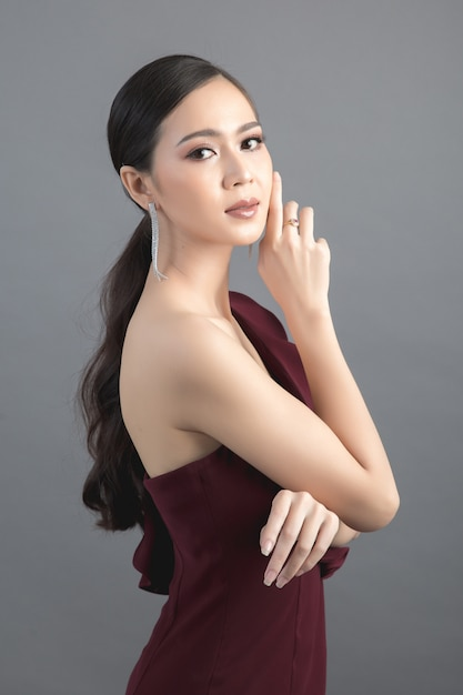 Beautiful woman face. hand of make-up Free Photo