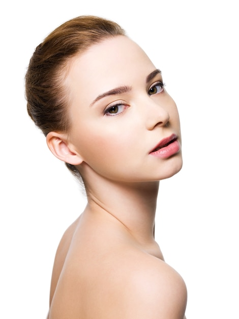Beautiful woman face with clean skin Free Photo