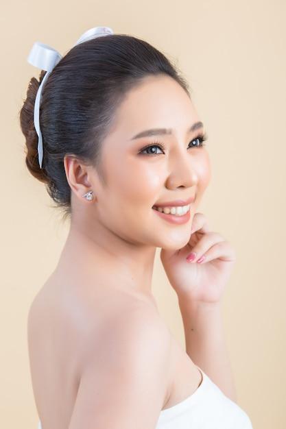 Beautiful woman face with makeup Free Photo