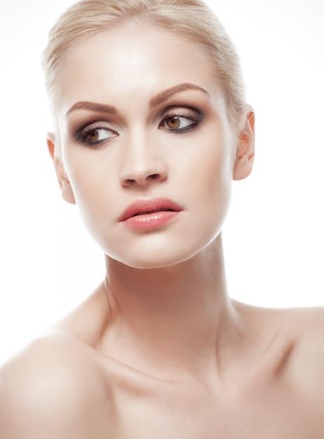 Beautiful woman girl natural makeup portrait with smokey eyes on white background Premium Photo
