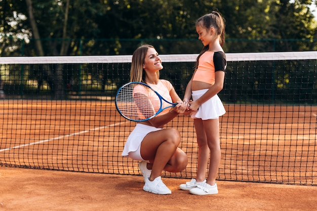 Beautiful woman giving directions on playing tennis Premium Photo