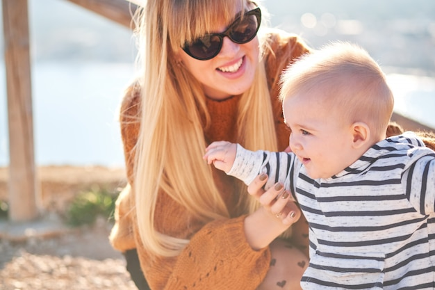 Beautiful woman and her cute little son are playing and smiling Premium Photo