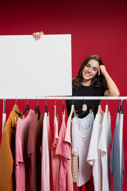 Beautiful woman holding an empty banner mock-up Free Photo