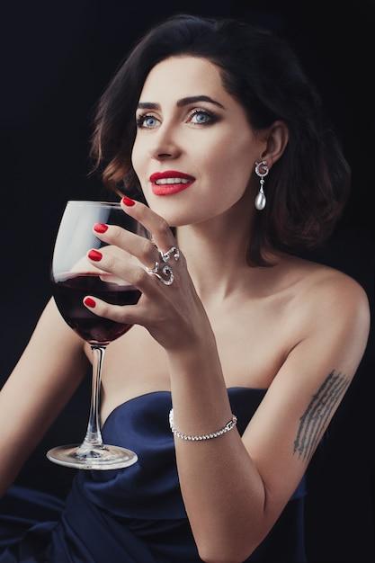 Beautiful woman holding a glass wine Premium Photo