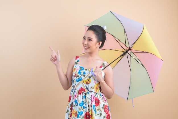 Beautiful woman holding a umbrella Free Photo