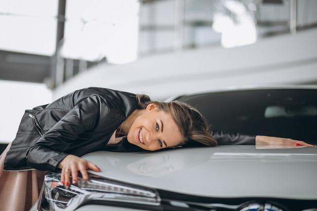 Beautiful woman hugging a car Free Photo
