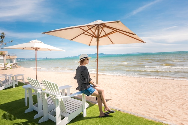Beautiful woman is relaxing on the beach , under umbrella Premium Photo
