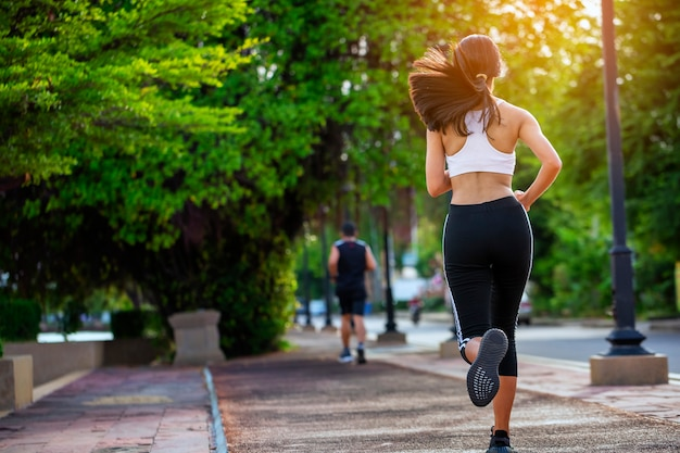 Beautiful woman jogger outdoor living healthy lifestyle in city park. Premium Photo