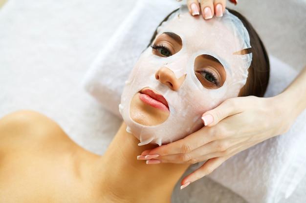 Beautiful woman lying with face mask. Premium Photo