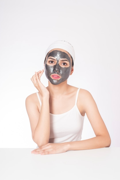 Beautiful woman masking her face on white background Premium Photo