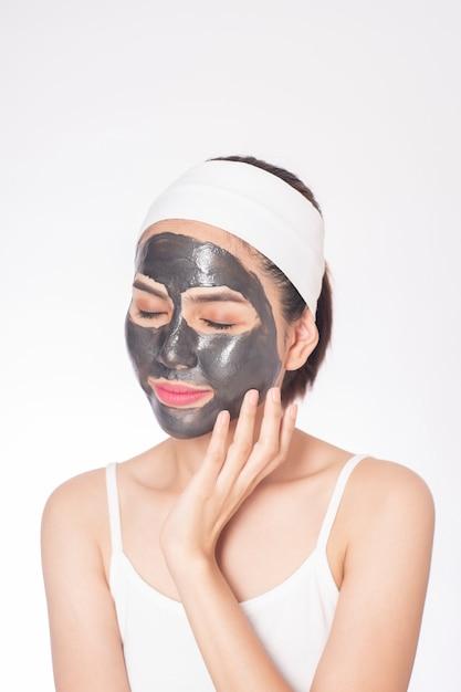 Beautiful woman masking her face on white background Premium Photo