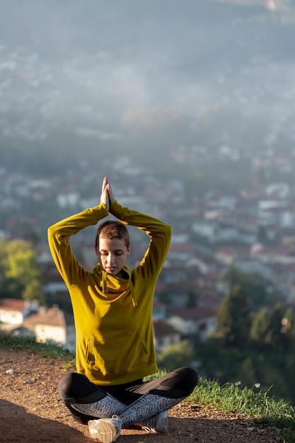 Beautiful woman meditating full shot Free Photo