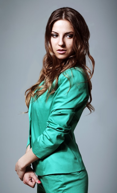 Beautiful woman in modern bright suit Free Photo