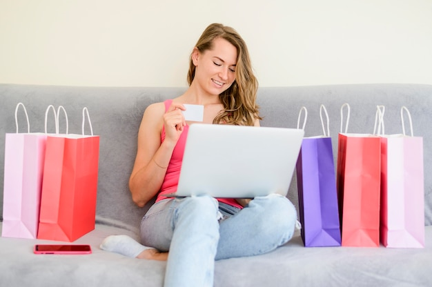 Beautiful woman ordering products online Free Photo