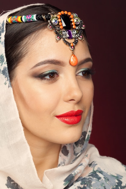 Beautiful woman in oriental style with mehendi Premium Photo