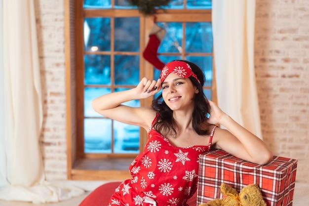 Beautiful woman in pajamas with gift box Free Photo