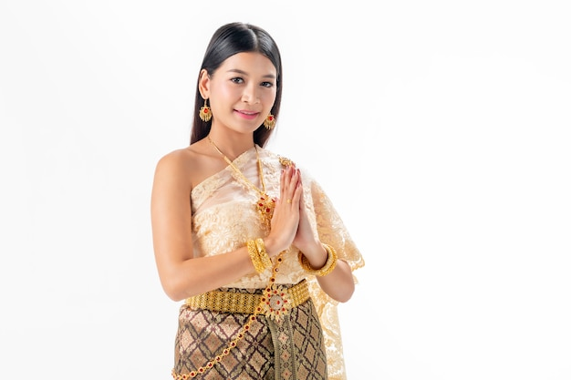Beautiful woman pay respect in national traditional costume of thailand. Premium Photo