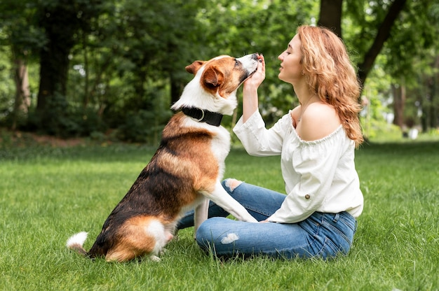 Beautiful woman playing with companion in the park Free Photo