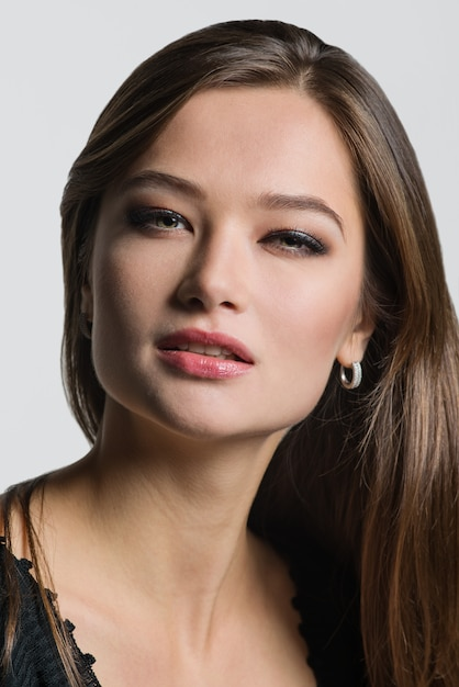 Beautiful woman posing on light background. Premium Photo