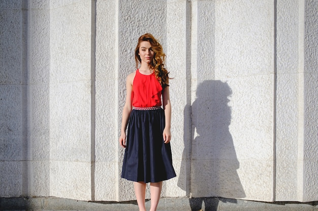 Beautiful woman posing on an urban wall Free Photo