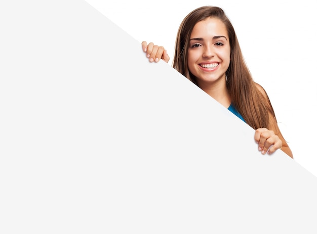 Beautiful woman posing with a blank placard Free Photo