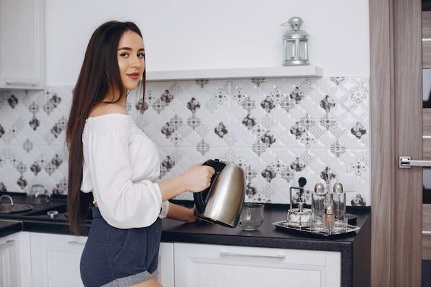 Beautiful woman prepare food in a kitchen Free Photo