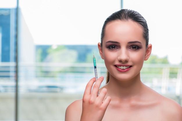 Beautiful woman preparing for botox injection Premium Photo