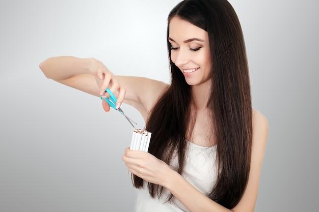 Beautiful woman quitting smoking cigarettes. stop smoking Premium Photo