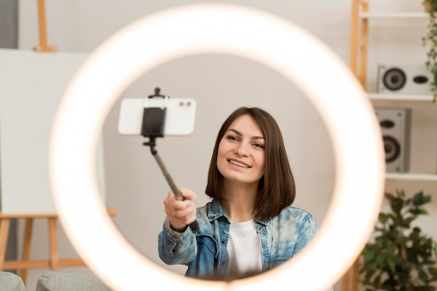 Beautiful woman recording herself at home Free Photo