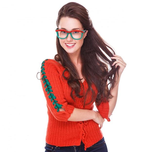 Beautiful woman in red sweater Free Photo