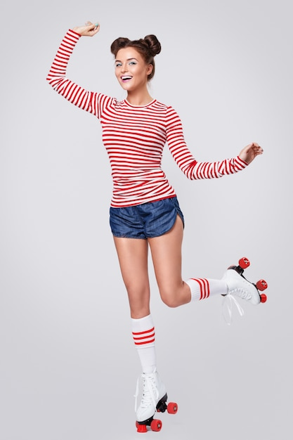 Beautiful woman in the roller-skates Premium Photo