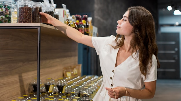 Beautiful woman shopping organic products Free Photo