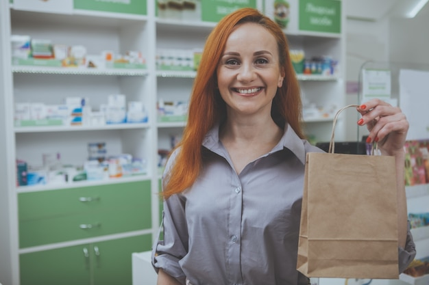 Beautiful woman shopping at the pharmacy Premium Photo