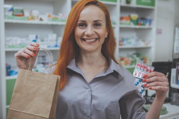 Beautiful woman shopping at the pharmacy Premium Photo