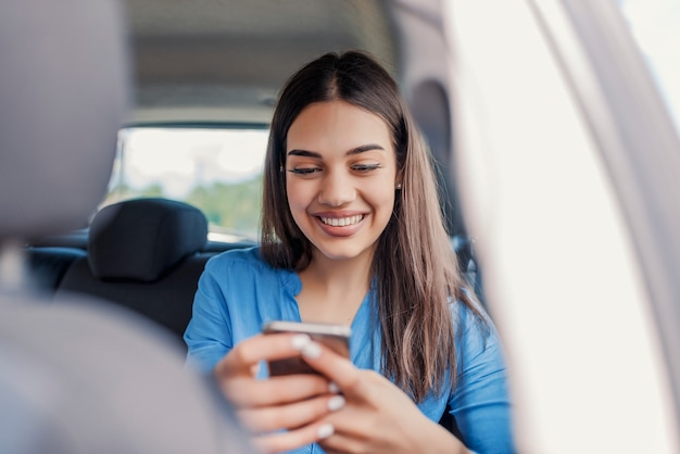 Beautiful woman smiling while sitting on the front passenger seats in the car. Premium Photo