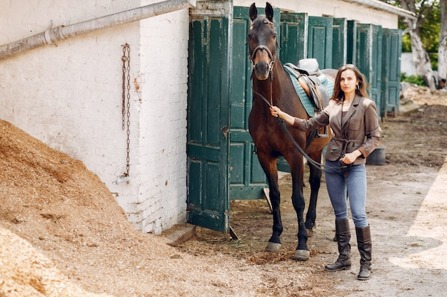 Beautiful woman spend time with a horse Free Photo
