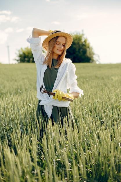 Beautiful woman in a summer field Free Photo