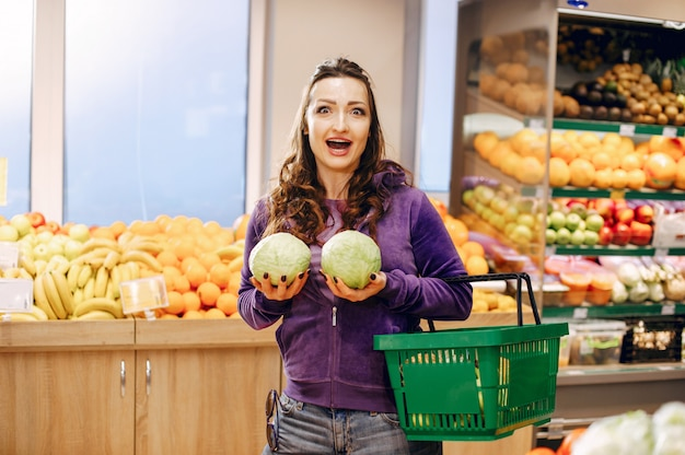 Beautiful woman in a supermarket Free Photo