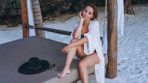 Beautiful woman in swim wear by the ocean Free Photo