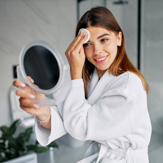Beautiful woman taking care of her face Free Photo