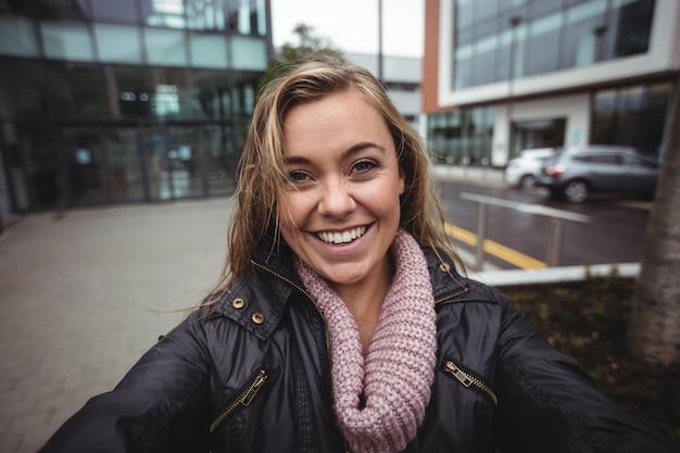 Beautiful woman taking a selfie on smartphone Free Photo